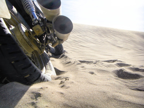 Motorcycle caught in the sand.