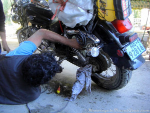 The boss fixing the chain guard.